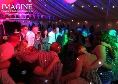 A full wedding reception dance floor