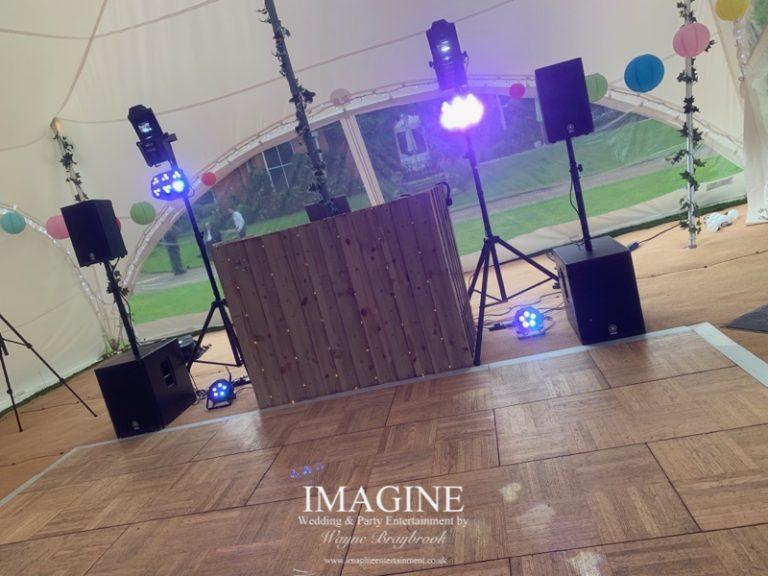 Rustic disco setup in a marquee venue